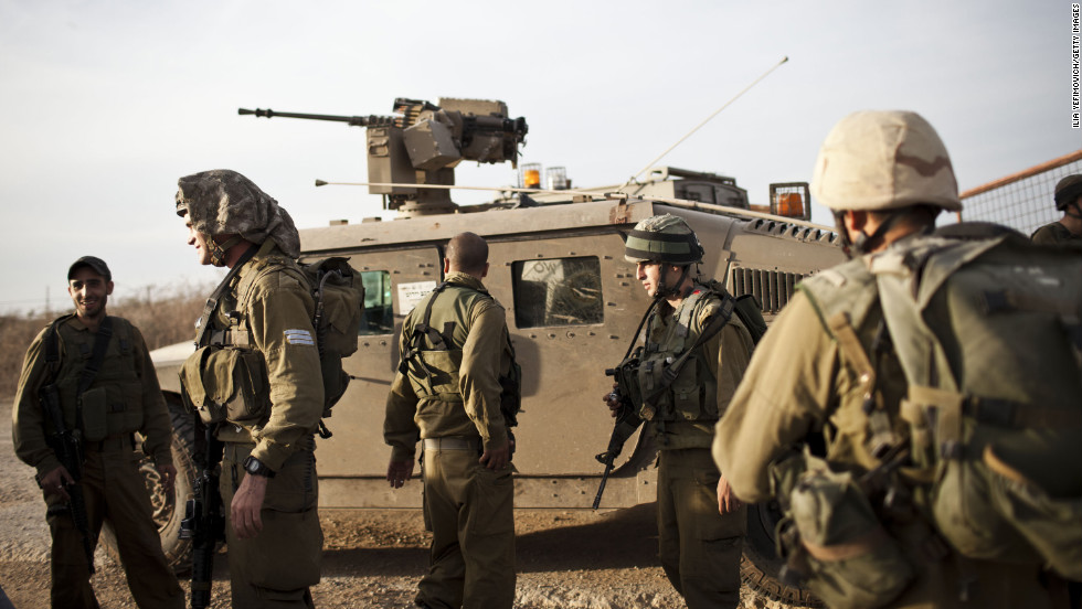 Israeli soldiers conduct a patrol as some 16,000 reserve troops are drafted in on Friday, November 16.