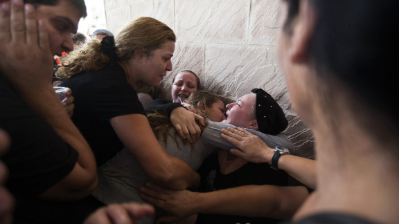 Relatives of Itzik Amsalam, who was killed Thursday, November 15, in Kiryat Malakhi, Israel, mourn during the funeral on Friday, November 16..