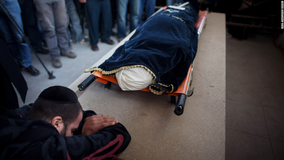 A relative grieves during the funeral for Itzik Amsalem in Kiryat Malakhi, Israel, on Friday, November 16.