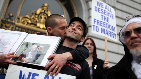Same-sex couple Frank Capley-Alfano (L) and Joe Capley-Alfano kiss at City Hall in San Francisco, California, on February 7.