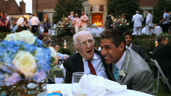 On August 21, 2010, TV reporter Roby Chavez, right, shares a moment with gay rights activist Frank Kameny during Chavez and Chris Roe