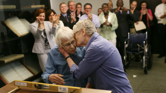 Phyllis Siegel, right, kisses her wife, Connie Kopelov, after exchanging vows at the Manhattan City Clerk
