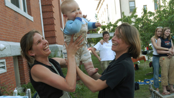 Lara Ramsey, left, and Jane Lohmann play with their 7-month-old son, Wyatt Ramsey-Lohmann. The two wed in 2004 after Massachusetts approved same-sex marriage. Massachusetts was the first state to do so.
