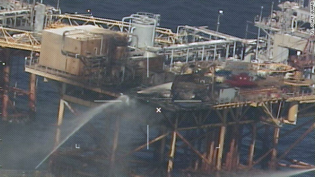 Commercial vessels extinguish a fire on board an oil platform approximately 20 miles off the coast of Grand Isle, Louisiana.