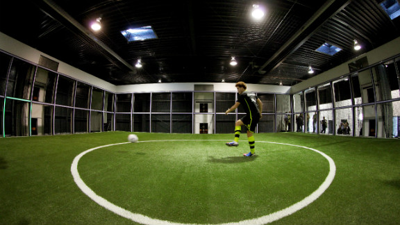 "The ""Footbonaut"" -- is a robotic cage which footballers can use to improve passing, spatial awareness and control. The machine is being used by German champions Borussia Dortmund."
