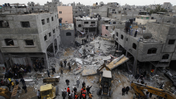 Palestinians gather at the site of an Israeli air raid in Gaza City on November 17, 2012. Israeli air strikes hit the cabinet headquarters of Gaza