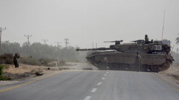 Israeli tanks maneuver at the Israeli-Gaza Strip border.
