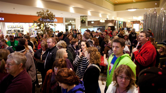 Bob Greene says earlier Black Friday store hours this year may lure people away from Thanksgiving gatherings.  Is it  worth it?