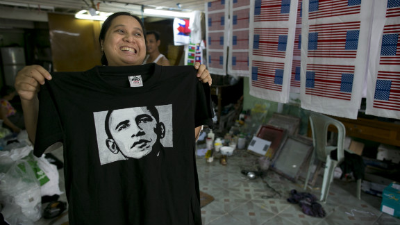 Kyu Kyu Mar, owner of Super silk screening shop, holds a T-shirt printed with an image of U.S. President Obama on Friday in Yangon.