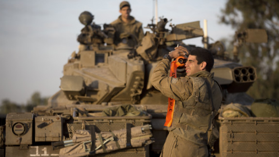 An Israeli soldier from a tank squadron adjusts the tank barrel at an Israeli army deployment area on Sunday, November 18.