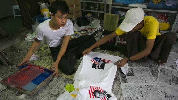 Two men silk-screen Obama T-shirts at a shop in Yangon on Sunday in preparation for Obama