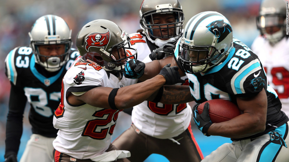 Jonathan Stewart of the Carolina Panthers runs into Leonard Johnson of the Tampa Bay Buccaneers during their game at Bank of America Stadium on Sunday in Charlotte, North Carolina.