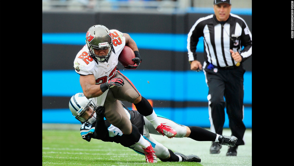 Haruki Nakamura of the Panthers tackles Doug Martin of the Buccaneers on Sunday.