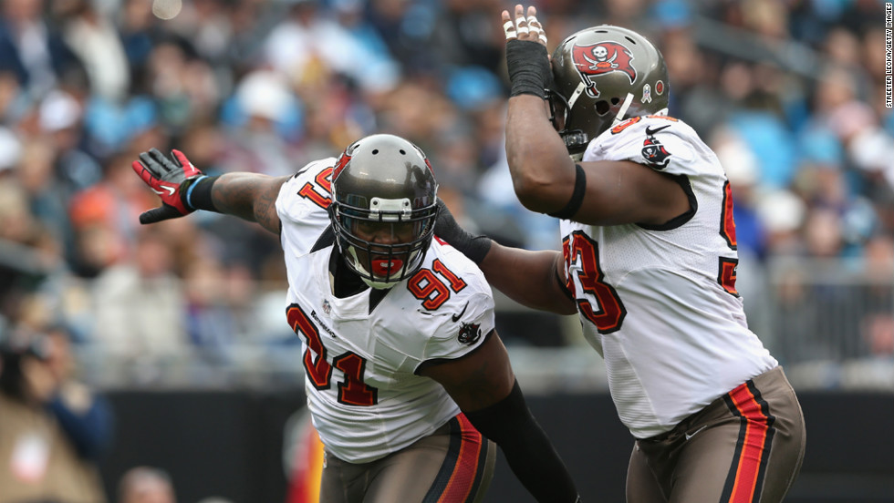 Da'Quan Bowers of the Buccaneers celebrates after a sack with teammate Gerald McCoy on Sunday.