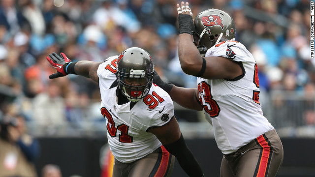 Tampa Bay Buccaneers Da'Quan Bowers, left, and Gerald McCoy celebrate after a sack during a game last season.