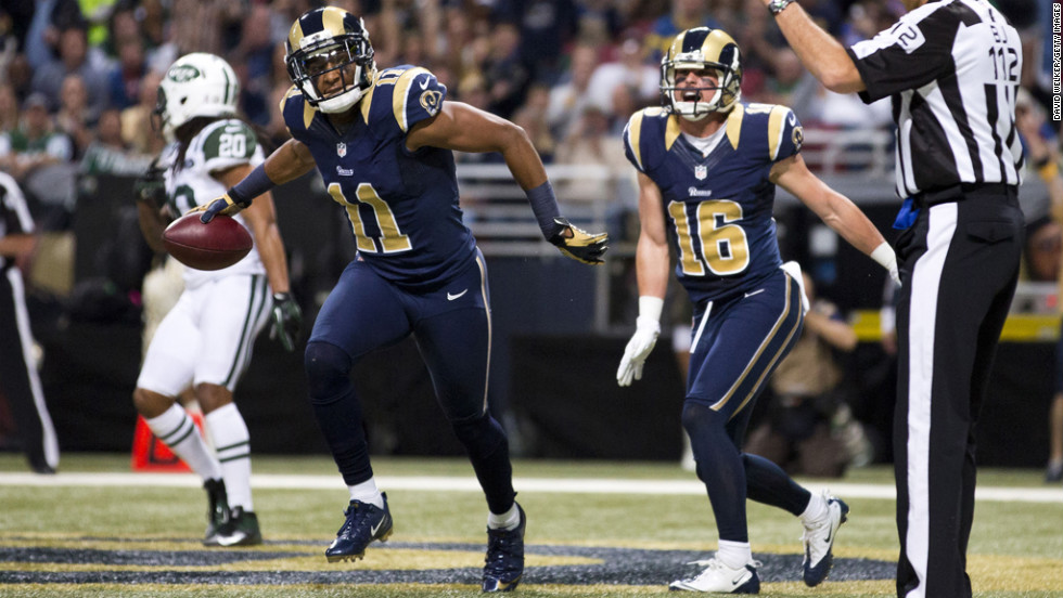 Wide receiver Brandon Gibson of the Rams prepares to throw the ball toward the crowd after catching a ball for a touchdown against the Jets on Sunday.