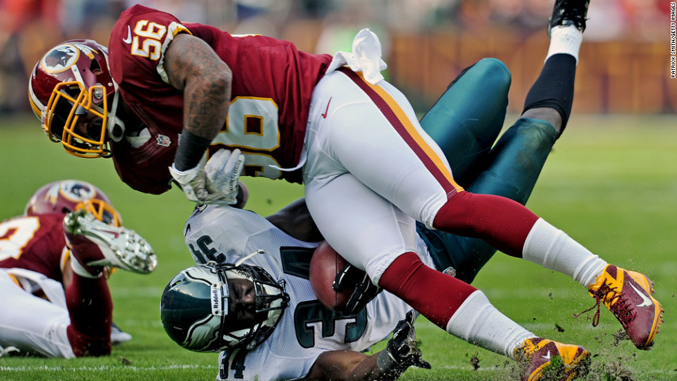 Running back Bryce Brown of the Eagles is hit by linebacker Perry Riley of the Redskins on Sunday.