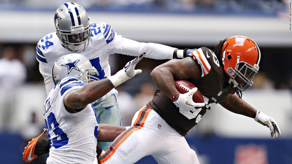 Trent Richardson of the Browns is tackled during a game against the Cowboys on Sunday.
