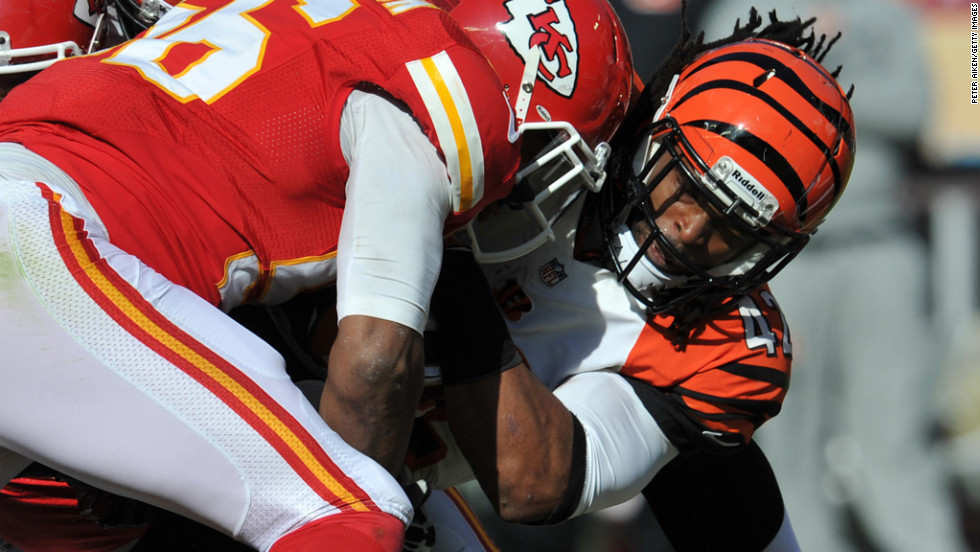 Running back BenJarvus Green-Ellis of the Bengals is tackled by linebacker Derrick Johnson of the Chiefs during the first half on Sunday.