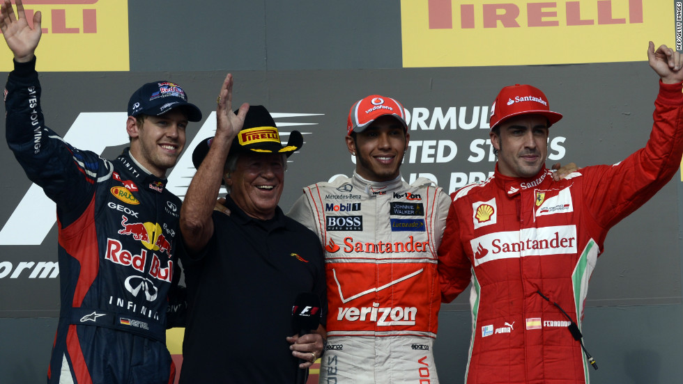 Hamilton's victory means Fernando Alonso (right) can still pip reigning world champion Sebastian Vettel (left) for the title in the final race in Brazil, with one of America's former F1 champs, Mario Andretti, also soaking up the adulation on Sunday.