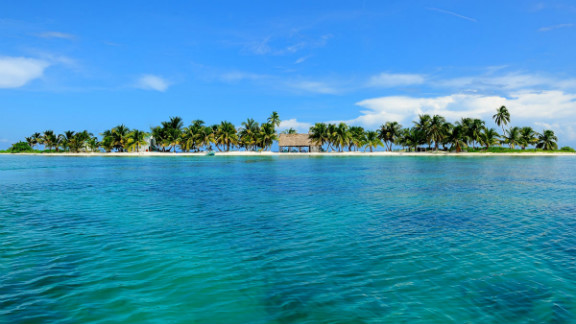 Eighteen kilometers off the coast from Placencia in southern Belize, tiny Laughingbird Caye is one of the most photogenic islands in the Caribbean.