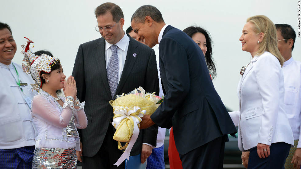 U.S. President Obama is greeted by a local woman as he arrives with U.S. Secretary of State Hillary Clinton in Yangon, Myanmar, on Monday.