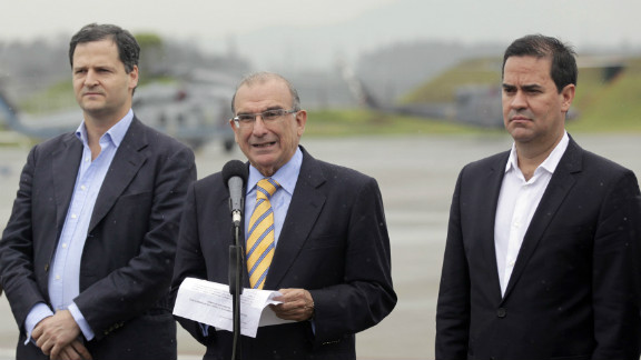 Colombia government negotiators speak prior to peace talks with the FARC on Sunday.