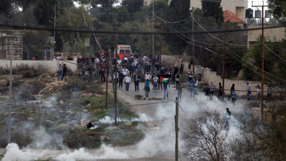 Birzeit University students clash with Israeli soldiers on Monday.