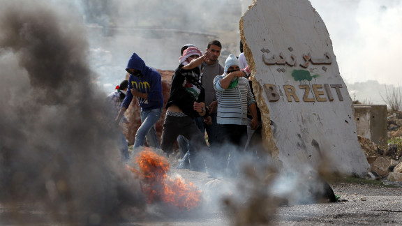 Birzeit University students clash with Israeli soldiers at the Atara checkpoint close to the West Bank university as they protest against Israel