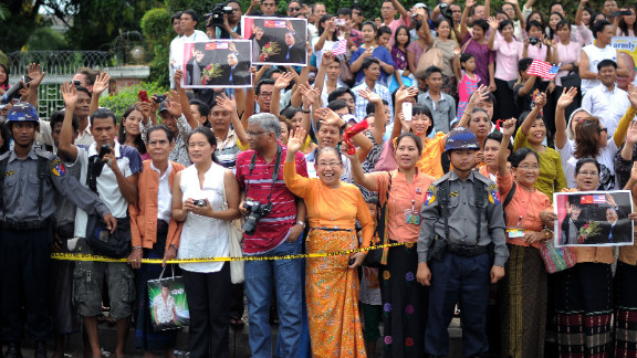 Local residents gather outside Aung San Suu Kyi