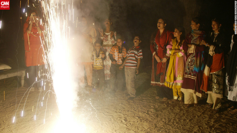 "<a href=""http://ireport.cnn.com/docs/DOC-882277"" target=""_blank"">Syed Yasir Kazmi</a> captured this photo of Diwali celebrations in Karachi, Pakistan. ""Everyone was happy, distributing sweets, doing prayer of Lukshmi Devi, and enjoying fireworks,"" he says. ""What was most special to me was the happiness and joy on everyone's faces."""