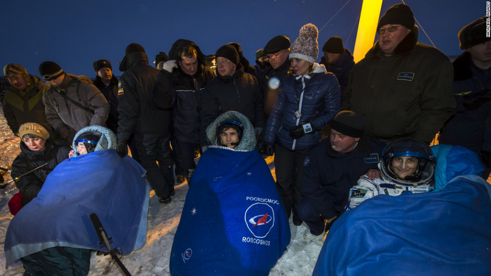 Flight engineer Akihiko Hoshide of Japan, from left, Yuri Malenchenko of Russia, also a flight engineer, and Sunita Williams of the United States, mission commander, sit  outside the Soyuz spacecraft minutes after landing on Monday.