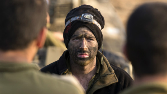 An Israeli soldier from a tank squadron attends a morning briefing at an Israeli army deployment area near the Israel-Gaza Strip border on  Monday.