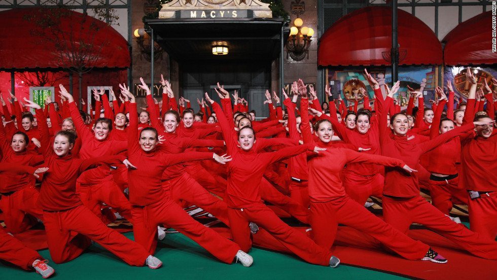 The Spirit of America cheerleaders perform in advance of Thursday's parade.