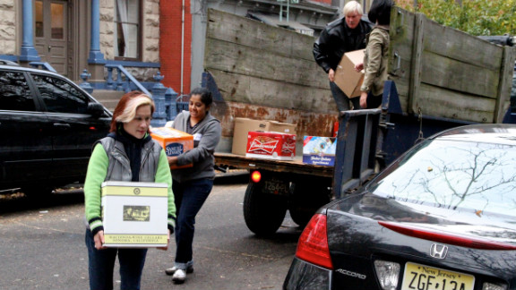 Volunteers carry supplies to a grass-roots relief hub for Superstorm Sandy's victims in Jersey City, New Jersey.