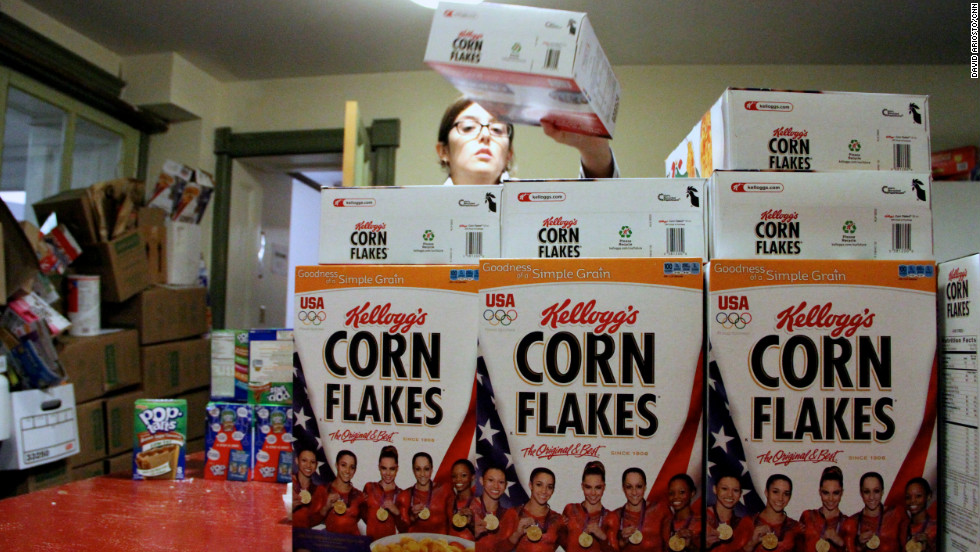 A volunteer stacks cereal donated by Kellogg's and the U.S. women's Olympic gymnastics team to storm victims.