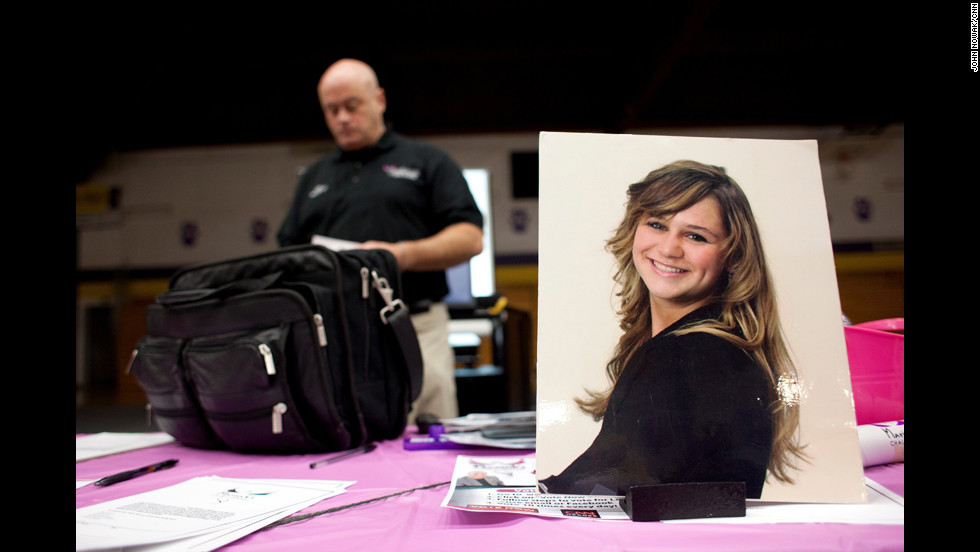 A portrait of Mariah sits on a table as McCarthy prepares to talk to a group of junior high and high school students in Boulder, Montana.