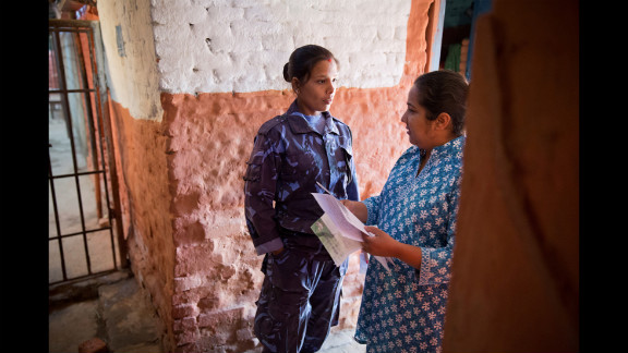 Basnet talks to a female prison guard to gain permission to go inside a jail in Kathmandu. Basnet was studying social work in college when she first visited a women's prison and discovered how many children had to live there.