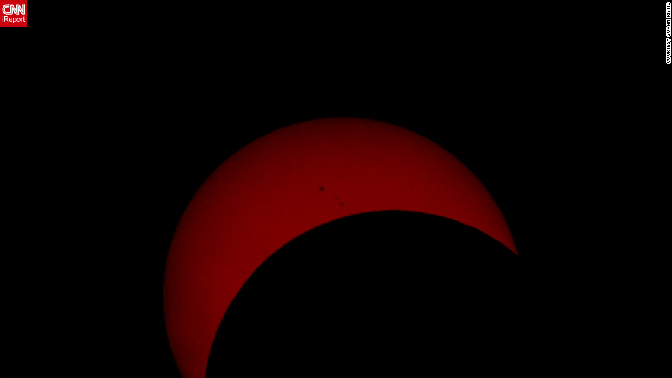 """The photograph I uploaded is approximately 17-18 minutes past the peak of the eclipse. The reason I chose that photo is because it shows a few Sun spots, and it's not just a solid block of reddish colour like those I took closer to the peak,"" says <a href=""http://ireport.cnn.com/docs/DOC-882137"" target=""_blank"">Goran Ristic</a> from Auckland, New Zealand."