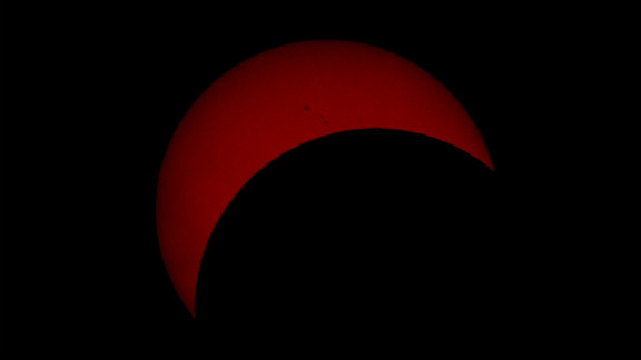 """""""The photograph I uploaded is approximately 17-18 minutes past the peak of the eclipse. The reason I chose that photo is because it shows a few Sun spots, and it's not just a solid block of reddish colour like those I took closer to the peak,"""" says Goran Ristic from Auckland, New Zealand."""