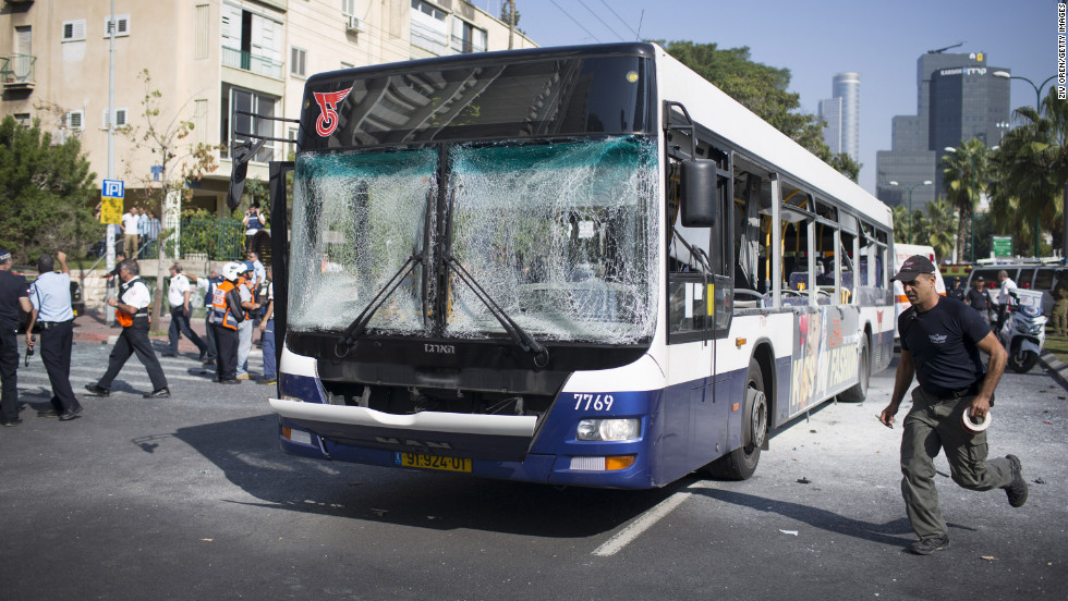Emergency services personnel work at the scene of an explosion on a bus Wednesday in Tel Aviv, Israel. The blast on the public transport bus left at least 22 injured, a hospital official said.