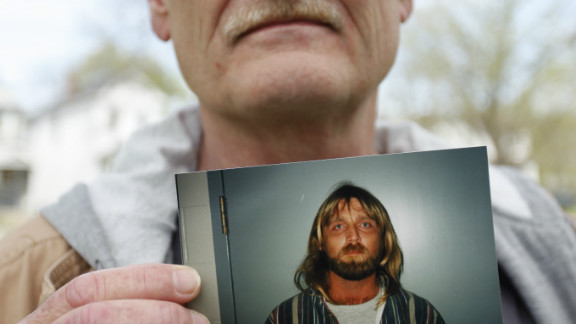 Clay Rogers holds a photo of his brother Glen Rogers, who is awaiting execution in Florida.