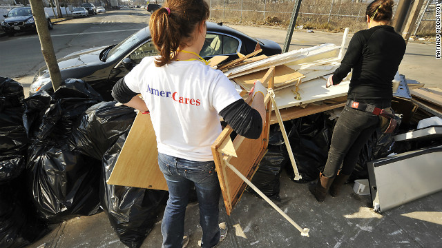 "AmeriCares volunteers help clean out flood-damaged homes in Queens, New York, during ""Operation Muck-Out."""