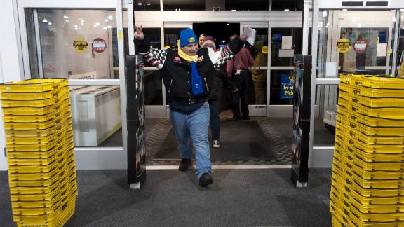 Gordon Kelly raises his arms as he crosses the threshold of the Best Buy in Eden Prarie, Minnesota on November 25, 2011 -- the store's earliest Black Friday shopper.