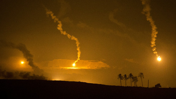Israeli-fired artillery flares illuminate the sky over the southern Israeli border with Gaza Tuesday as fighting continues.