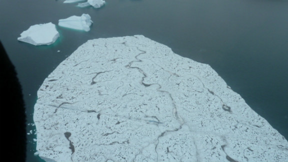 Giant icebergs beneath the helicopter. Some can easily be as long as an aircraft carrier.