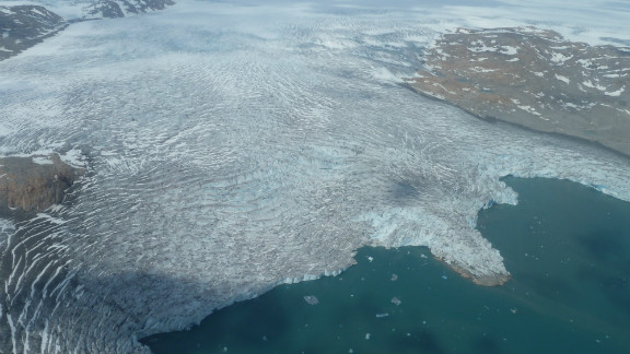 Giant glacier with icebergs calving off in southern Greenland.