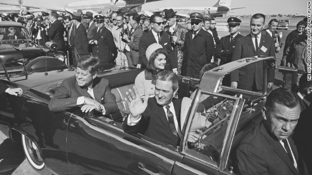 Kennedy rides through Dallas on November 22, 1963.