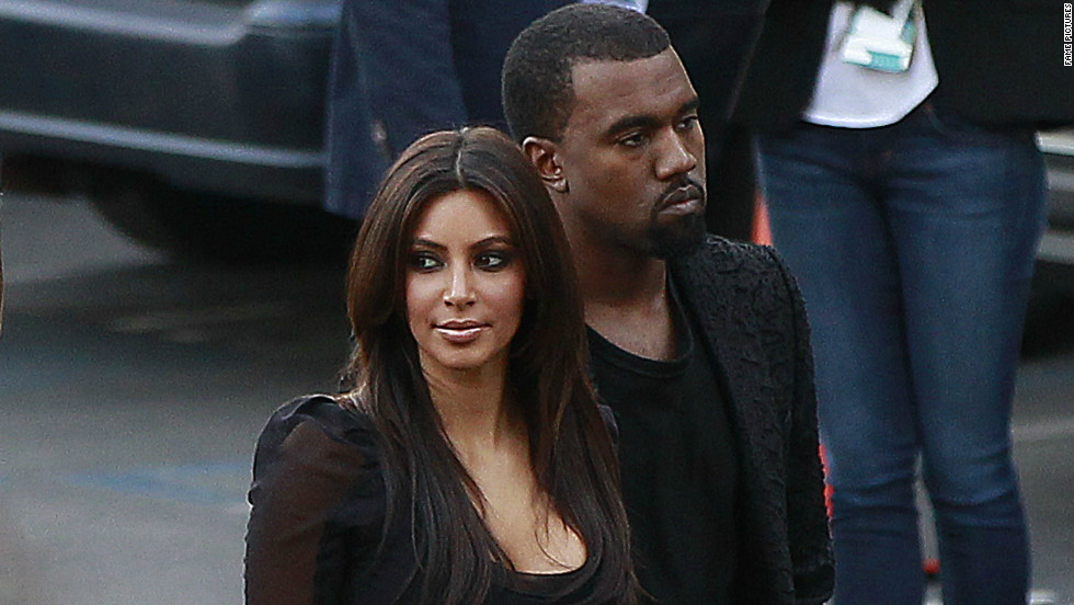 "Kim Kardashian and Kanye West attend a taping of ""The X Factor"" on November 21."