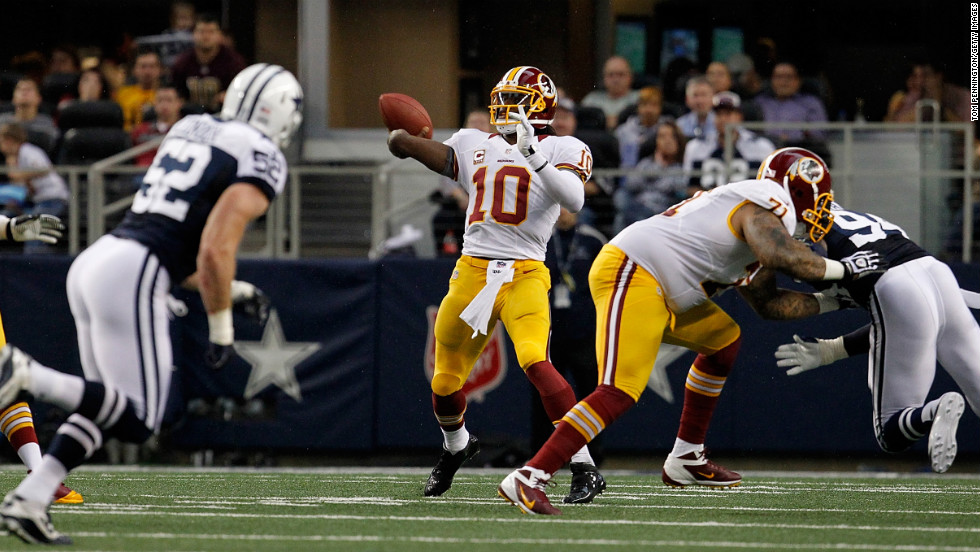 Quarterback Robert Griffin III of the Washington Redskins looks for an open receiver during Thursday's game against the Dallas Cowboys.